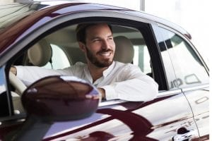 Businessman in car driving